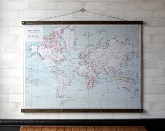 Framed vintage world map etsy world map 1915 vintage pull down map reproduction canvas fabric print wood poster hangers with brass wall hanging framed art gumiabroncs Images