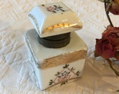 Vintage Porcelain Inkwell With Hand Painted Flowers and Textured Gold Details With Vines and Curved Shapes. Metal Edged Opening and Hinge.