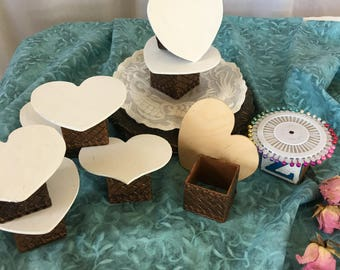 Craft Display Platforms. White Painted Wood Heart Shape Top With Plastic Basket Weave Square Bottom. Craft Display Platform.