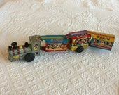 Vintage 1960s Linemar Wind Up Toy Tin Train. Engine and Three Cars With Animals, Clowns and Musical Men.