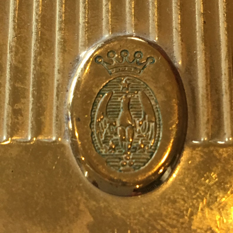 Worn Tag on Back. Ovan Emblem With Eagle Star and Crown on Top Near the Opening Vintage Gold Round Ridged Powder Compact
