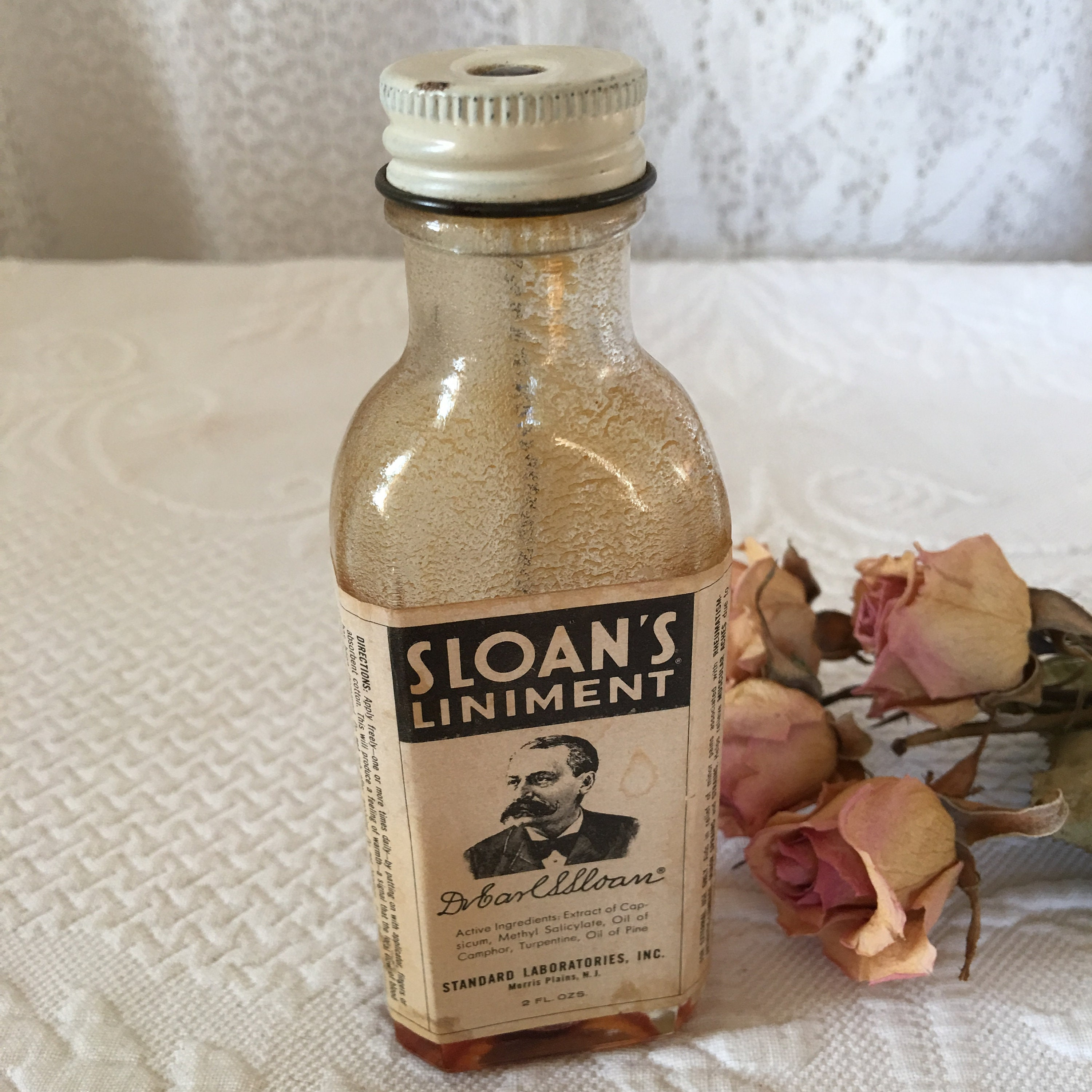 Vintage Sloan's Liniment Bottle With Original Label  Glass Medicinal Bottle  With Metal Screw On Top and Applicator  Some Liniment Inside