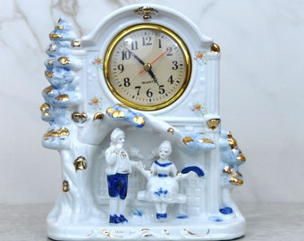 Vintage Mantle Clock, Blue And White Porcelain with Gold Colored Accents, 1970s, Colonial Period Style, Man And Woman Sitting In Park