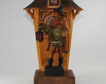 Vintage Statue of a Night Watchman standing in front of a clock. Made in West Germany 1970s
