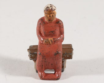 Vintage Barclay Manoil Lead Figure, Woman Sitting On A Bench, 1950s