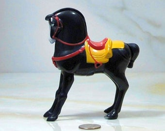 Vintage McDonalds Happy Meal Toy, Khan from Mulan 2. This is a plastic wind-up toy still sealed in the factory plastic.