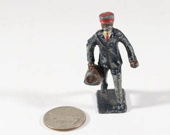 Vintage Barclay Manoil Lead Figure, Train Conductor Carrying a Bag, 1950s