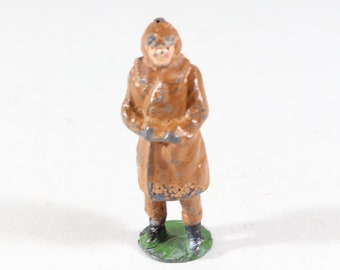 Vintage Barclay Manoil Type Lead Figure, Woman In A Brown Dress, 1950s