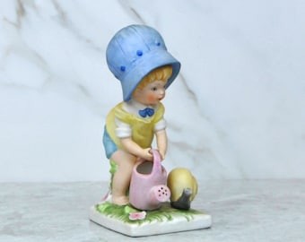 Vintage Seymour Mann Bisque Porcelain Loveables Figurine, Girl In Her Garden Watering Plants, Luv-17, 1970s