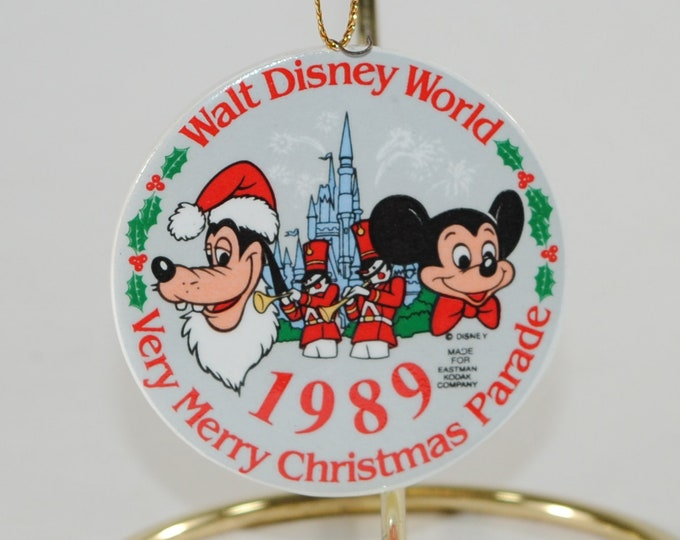 Featured listing image: Vintage Disney Christmas Ornament Walt Disney World Very Merry Christmas Parade, 1989, Made For Eastman Kodak Company