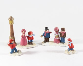 Vintage Christmas Figures Singing Christmas Carols in the Town Square, 1970s