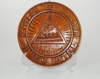 Vintage Handmade Round Wood Wall Hanging that reads Central America Republic De Nicaragua 1980s