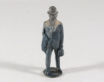 Vintage Barclay Manoil Lead Figure, Man Carrying Coat and Bag, 1950s