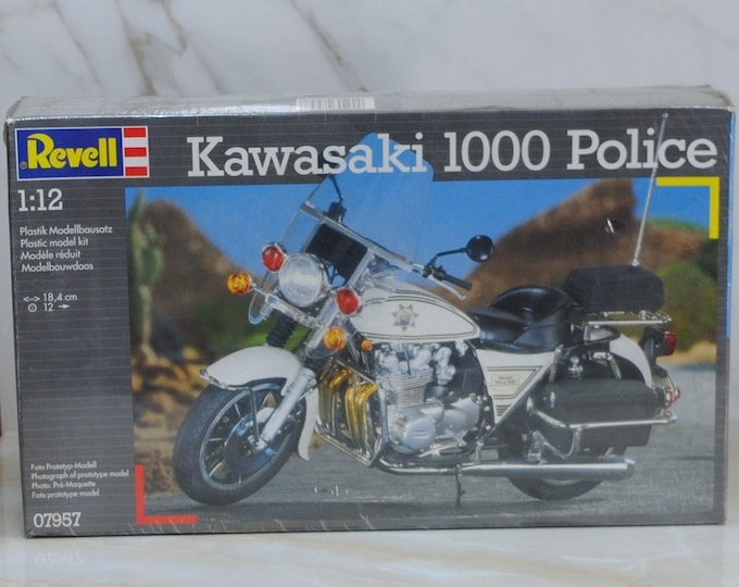 Vintage Kawasaki 1000 Police Motorcycle Revell Model Kit from 1993. This is a complete, factory sealed kit