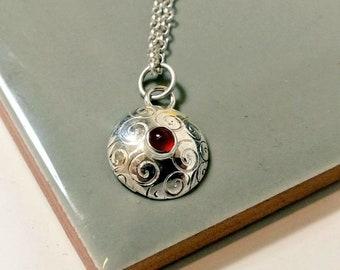 Sterling silver domed spiral design pendant