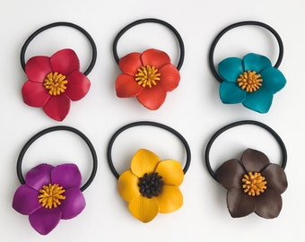 Pretty lady's leather flower ponytail hair ties