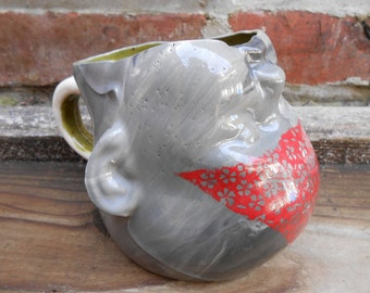 Triangle Baby Head Slip Cast Mug