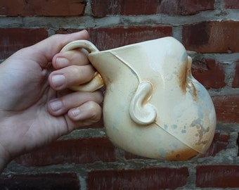 Splotched Baby Head Mug