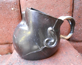 Smokey Slip Cast Baby Head Mug