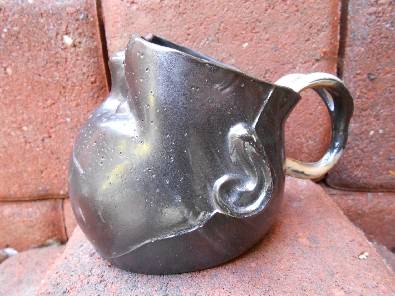 Smokey Slip Cast Baby Head Mug