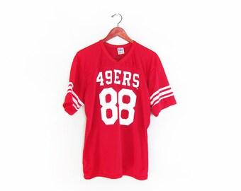 b9d0b9736 vintage jersey   San Francisco 49ers   striped   1980s striped SF 49ers  football jersey Medium
