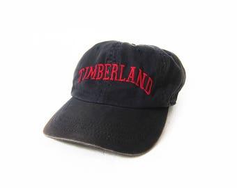 c91c38261e1 vintage baseball hat   Timberland hat   90s dad hat   1990s navy Timberland  strap back hat dad hat