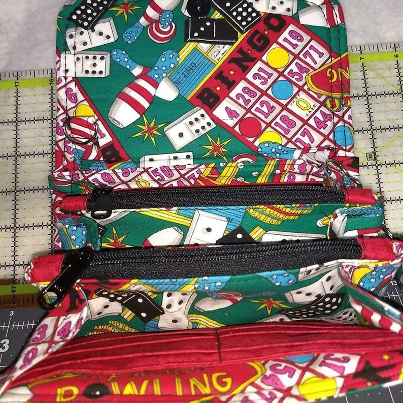 Necessary Clutch Wallet made with bingo and bowling and domino fabric NCW