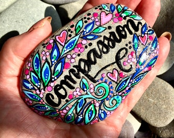 compassion/painted rocks/painted stones/altar stones/boho art/hippie art/desk art/paperweights/cape cod/word rocks/word for the year/rocks