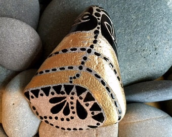 Golden Tribal Bell / painted rock / Sandi Pike Foundas / Sea stone from Cape Cod