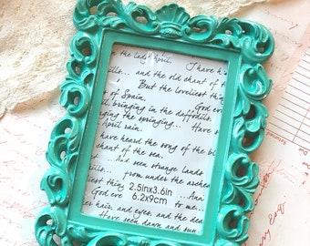 Charming Aqua Resin Frame Embellishment perfect for mini scrapbook albums, crafting.