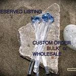 Custom made glass coffee stirs by OceanBeachGlass