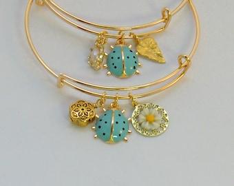Aqua gold enamel ladybug bangle, stackable ladybug garden bangles, flower and leaf bracelets, gold and white leaf and flower jewelry, animal