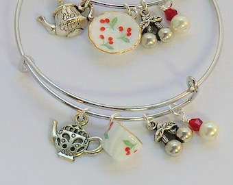China cherry charm tea bangles, red white and green cherries, teapots, cups and saucers for tea time, cherry charm bracelets, floral china