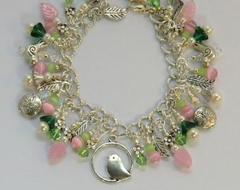Bird and butterfly charm bracelet, garden green pink silver flower and leaf charm bracelet, garden jewelry, bird bracelets,animal jewelry