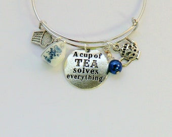 Blue delft china teacup charm bangle, A Cup of Tea Solves Everything, teapot charm bangles, cupcake charm bangles, crystal and pearl bangles