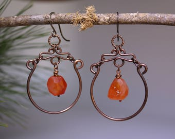Free form copper chandeliere earrings with faceted Carnelian nuggets