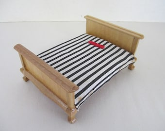 Minature dollhouse bed with mattress stained and varnished