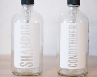 Clear Glass with White Label Shampoo and Conditioner Dispenser Set