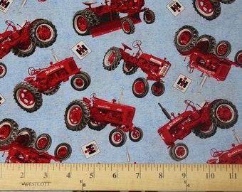 Farmall Tractor and Logo Toss Fabric, light blue