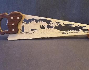 Scenic wooden hand saw, covered bridge.