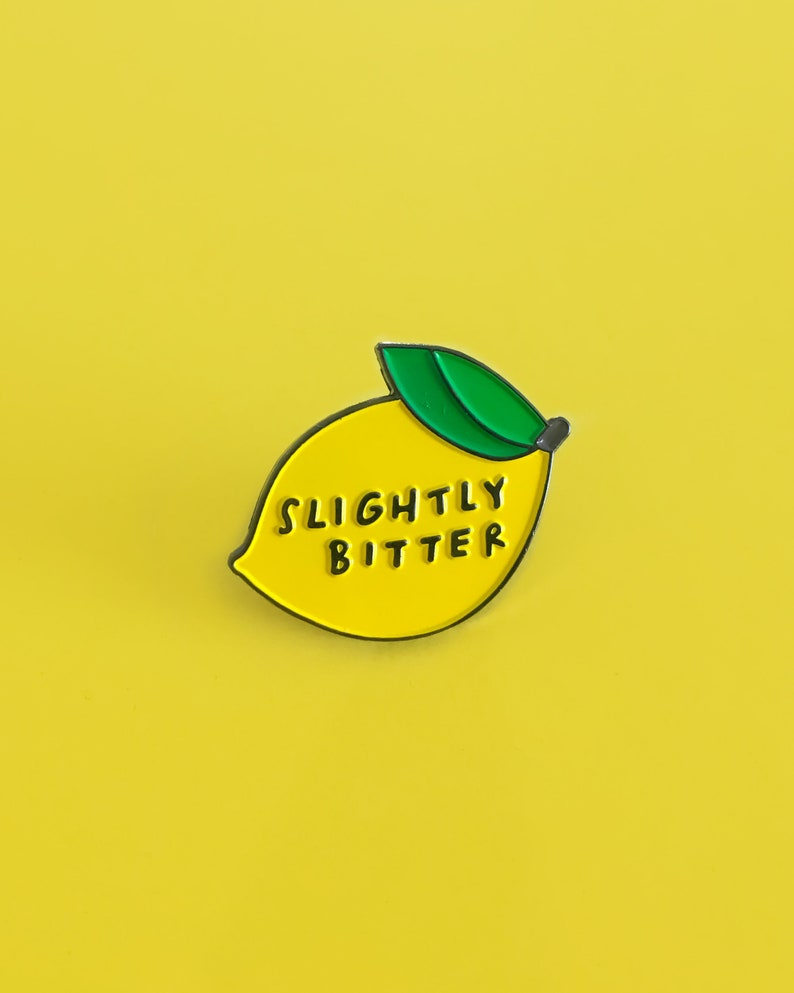 The OG Slightly Bitter enamel pin image 0