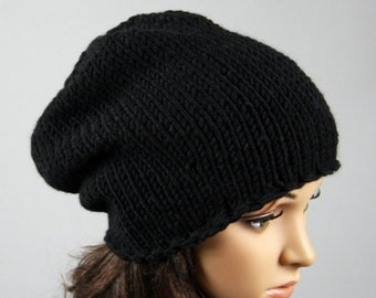 61f37854b58 Hand knitted unisex slouchy beanie. A lovely hat for men and women  available in black.