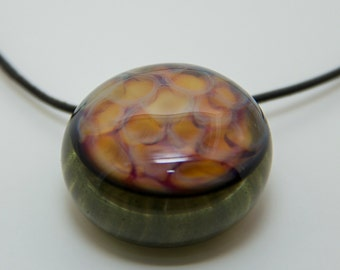 Glass honeycomb pendant with black leather adjustable necklace.