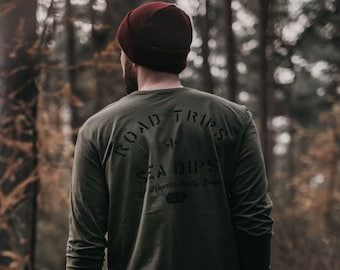 Hand Printed 'Road Trips + Sea Dips' Olive Green Long Sleeve T-Shirt by Art Disco