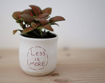 "White ""Less is more"" ceramic cup or planter"