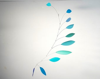 Kinetic mobile made from recycled plastic bottles for your eco home. Turquoise blue hanging mobile, made by Becky Crawford from Spacefruit
