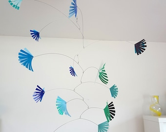 Kinetic mobile for nursery or living room in blues and greens. Handmade from recycled plastic bottles for your eco home by Becky Crawford