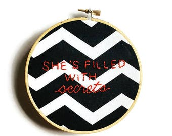 She's filled with secrets embroidery hoop wall art