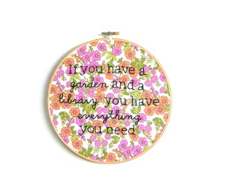 A garden and a library embroidery hoop wall art