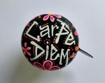 carpe diem, painted bicycle bells, pink and black, black and white, carpe diem art, popular phrases, popular quotes, pink flowers, bike bell